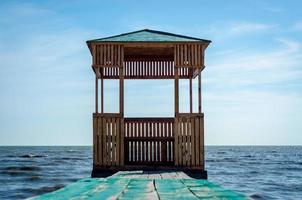 Wooden arbor on the water photo