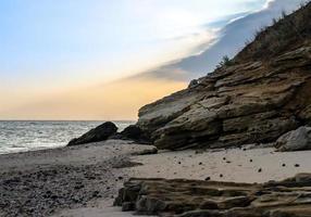 Rocky seashore against the evening sky