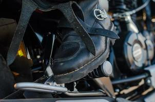 Close-up of a boot on a motorcycle photo