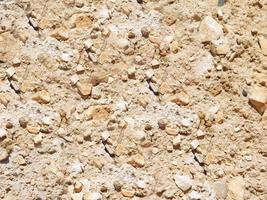 Primer plano de la pared de piedra o roca de fondo o textura foto