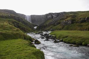 Waterfall on the ring road in Iceland photo
