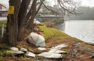 Canoes and kayaks on the river bank photo
