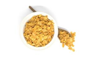 Corn flakes and bowl isolated on a white background photo