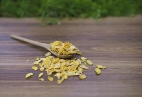 Corn flakes on wood table photo