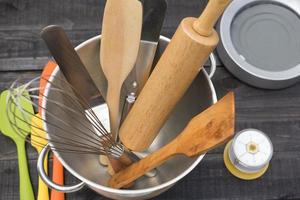 Bakery and cooking tools with a kitchen timer on a wooden table photo
