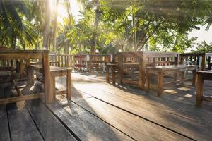 Corner restaurant near the sea with rays of sunlight photo