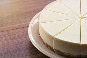 Cheesecake on a white plate on a wooden table