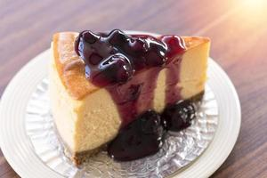 Homemade blueberry New York cheesecake on a white plate