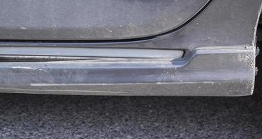 Scratches on the body of a gray car from an auto accident