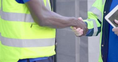 Close Up of Two Workers Shaking Hands