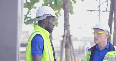 Two Workers Discussing a Plan on the Job
