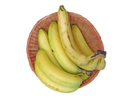 Bananas on a wicker plate isolated on a white background photo