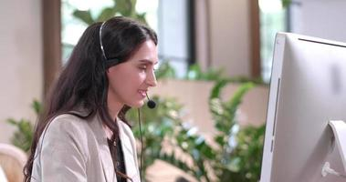 Woman Wearing a Headset and Working at a Desk video