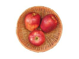 Apples in a wicker bowl isolated on a white background photo