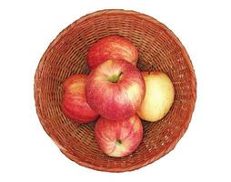 Apples in a wicker bowl isolated on a white background. photo