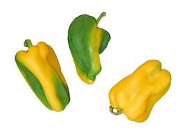 Yellow and green bell peppers on a white background