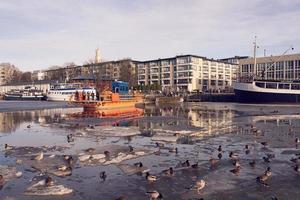 Turku, Finland, Mar 23, 2021 - Ferry on frozen Aura river
