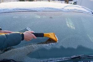 Swiping ice off a windshield photo