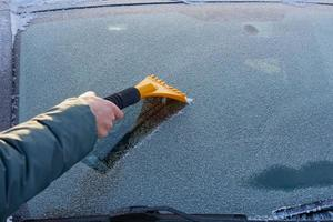 Scraping ice off a windshield photo
