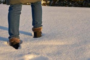 Close-up of a person walking through the snow
