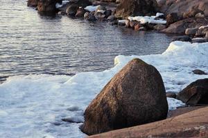 Icy seashore with rocks