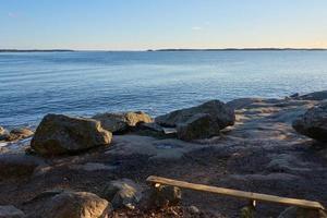 Bench on the coast photo