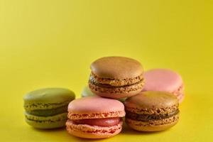 Macaroons on a yellow background photo