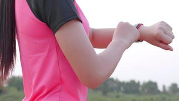 Woman Setting Smart Watch Before Workout video