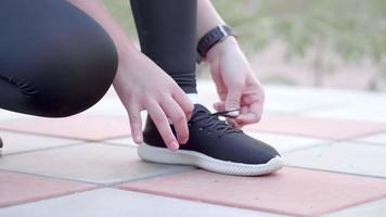 Close Up Tying Shoes While on a Run