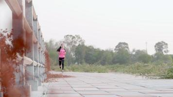Young Asian Woman Out on a Jog video