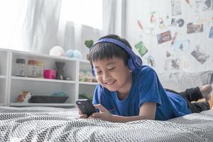Boy listening to music on a bed