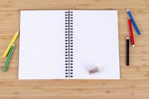 Notebook and colored pencils photo