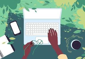 Hands of an African American woman behind a laptop. Top view. Freelancer works outdoors in a park in spring. Flat vector illustration