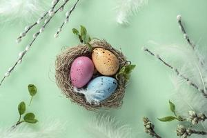 Easter background with pussy-willow painted eggs in the nest. Orthodox Easter, pussy-willow Sunday
