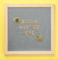 Golden virtual money Bitcoin coin with frame and text Bitcoin Accepted Here. Concept of bitcoin payment, shopping or purchase and cryptocurrency accepted photo