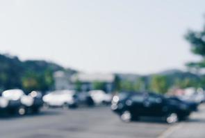 Blurred car park with many cars photo
