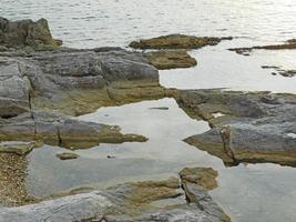 Rocky beach by the sea photo