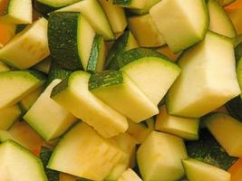 Diced zucchini on a wooden tabletop background
