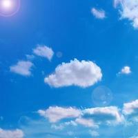 Lens flare in blue sky photo
