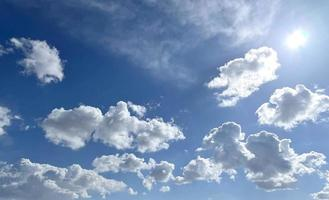 Bright sunny day with blue sky with white clouds photo