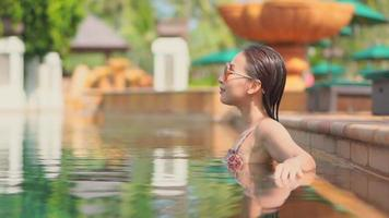 Woman Relaxes Around the Pool with Sun Glasses video