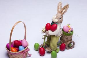 Easter eggs and bunny rabbit on white background photo