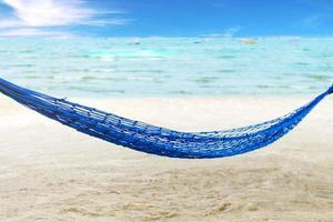 Hammock on a palm tree at Pattaya Beach, seascape ocean and blue sky photo