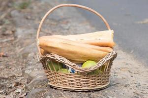 Basket filled with food for a picnic in the countryside