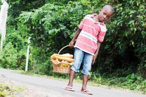 Child holding a basket of food