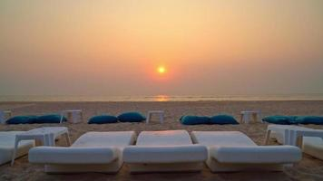 Beach Bean Bags with Ocean Background at Sunset video
