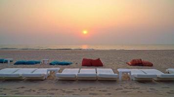 Beach Bean Bags and Chairs With Ocean Background at Sunset video