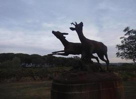 Sculpture dedicated to deer and hunting activity in nature photo