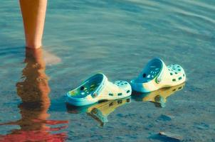 Blue rubber shoes in water