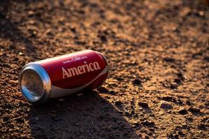 Share a Coke With America can littered on the ground in the USA